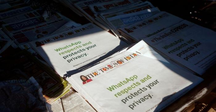 A WhatsApp advertisement is seen on the front pages of newspapers at a stall in Mumbai