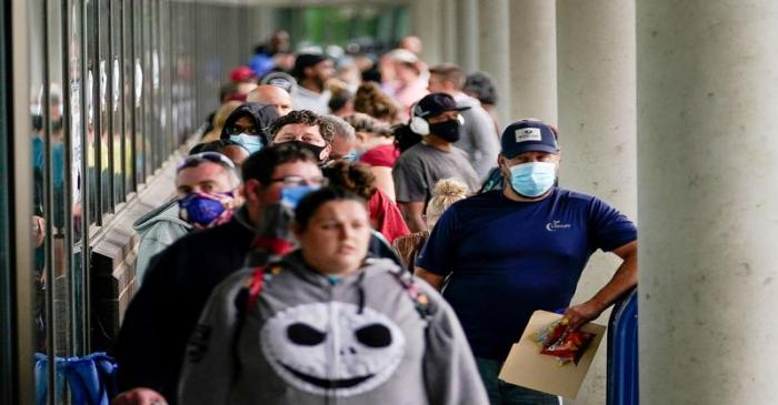 FILE PHOTO: Hundreds of people line up outside a Kentucky Career Center hoping to find