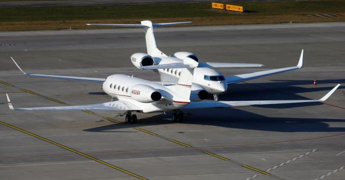Two Gulfstream GVI G650 GLF6 business aircrafts are parked at the airport in Zurich