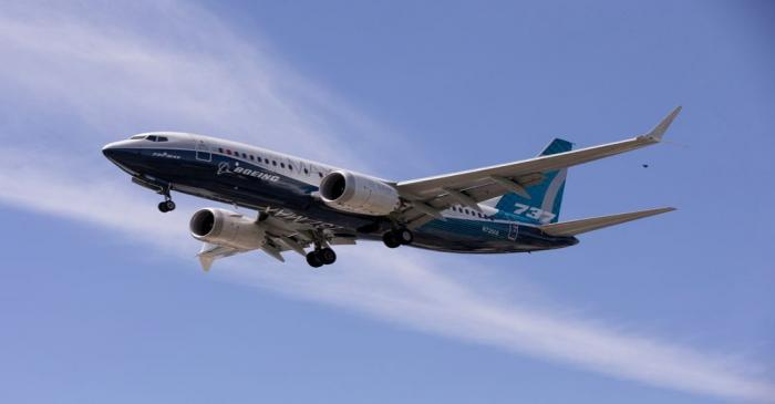 FILE PHOTO: A Boeing 737 MAX airplane lands after a test flight at Boeing Field in Seattle