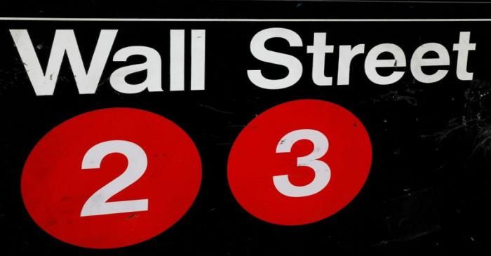 FILE PHOTO: A sign for the Wall Street subway station is seen in the financial district in New
