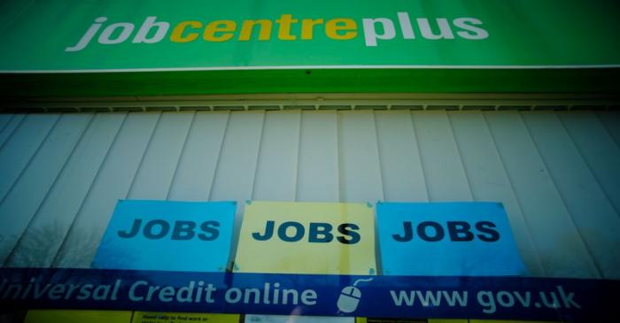 Adverts for jobs are seen in the window of a Jobcentre Plus  in Manchester