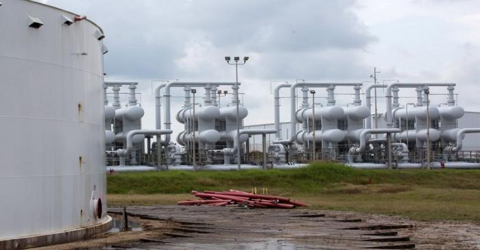 FILE PHOTO: An oil storage tank and crude oil pipeline equipment is seen during a tour by the