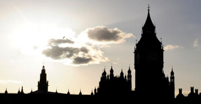 FILE PHOTO: The sun sets behind Britain's House of Commons and Big Ben in central London