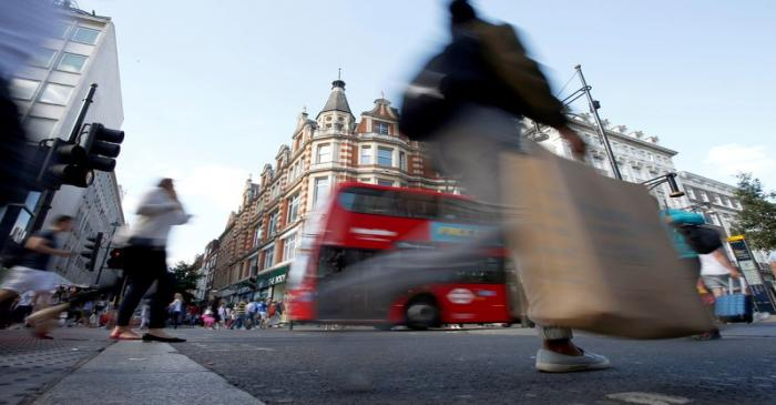 FILE PHOTO: File photo of shoppers crossing the road in Oxford Street, in London