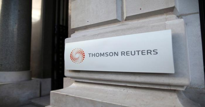 FILE PHOTO: The logo of Thomson Reuters is pictured at the entrance of its Paris headquarters,