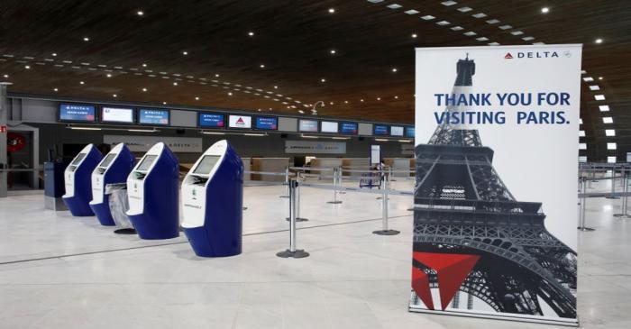 FILE PHOTO: American airlines company Delta registration desks are deserted at Paris Charles de