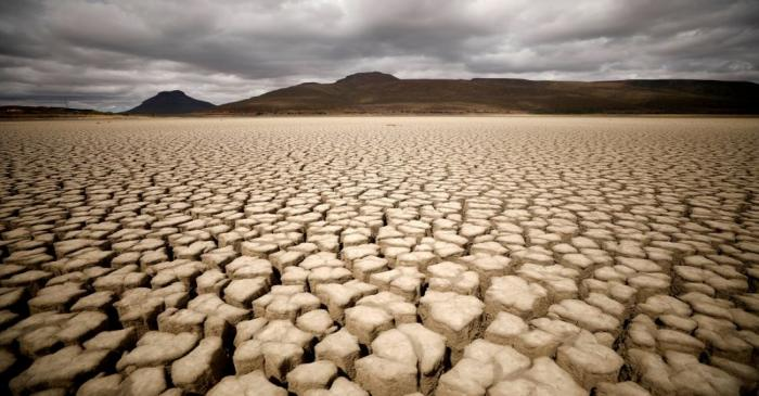 FILE PHOTO: Clouds gather but produce no rain as cracks are seen in the dried up municipal dam