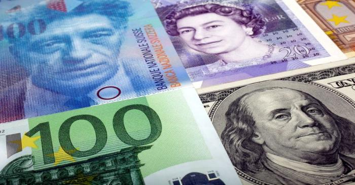 FILE PHOTO: A picture illustration of  U.S. dollar Swiss Franc British pound and Euro bank