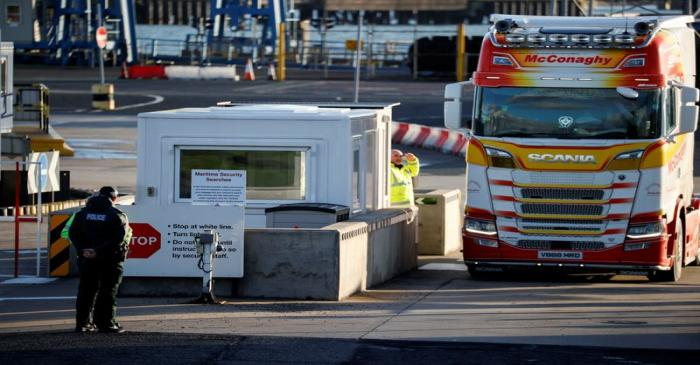 FILE PHOTO: Police officers stand by port security at the entrance to the Port of Larne