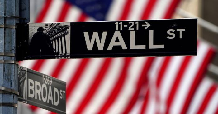 FILE PHOTO: A Wall Street sign is pictured outside the New York Stock Exchange in New York