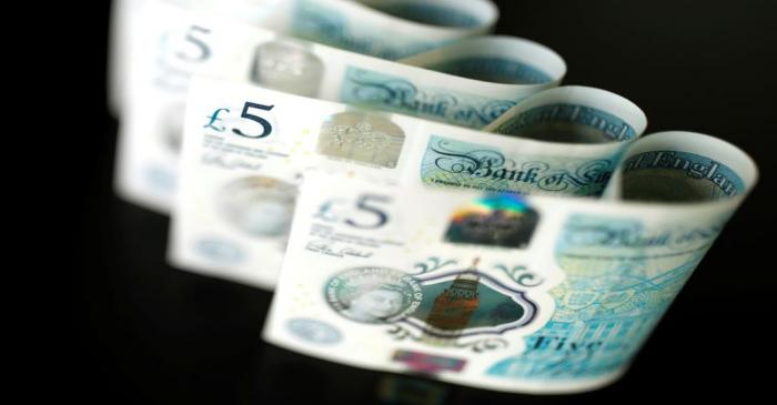 British five pound banknotes are seen in this picture illustration