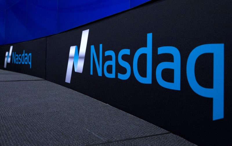FILE PHOTO: The Nasdaq logo is displayed at the Nasdaq Market site in New York