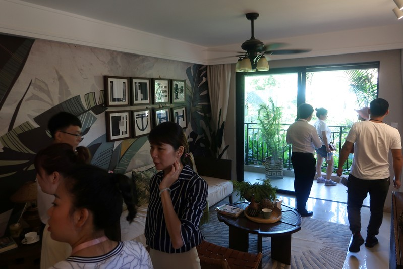 People on a property tour visit a show flat of a real estate property developed by Sunac China