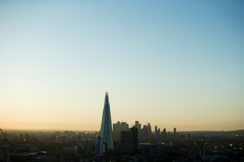 FILE PHOTO: The London skyline can be seen during sunrise on the day of the Summer Solstice,