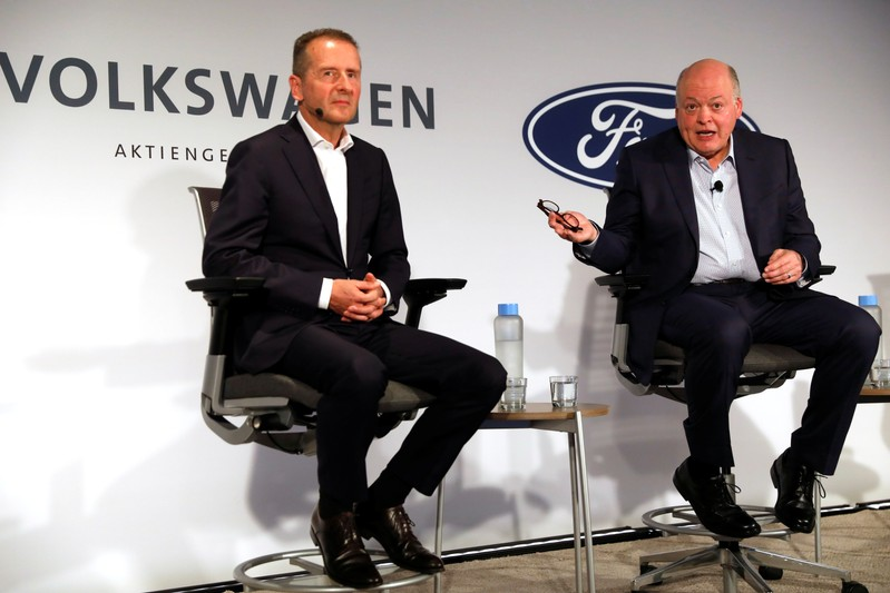 Ford President and CEO Jim Hackett and Volkswagen AG CEO Dr. Herbert Diess attend a news