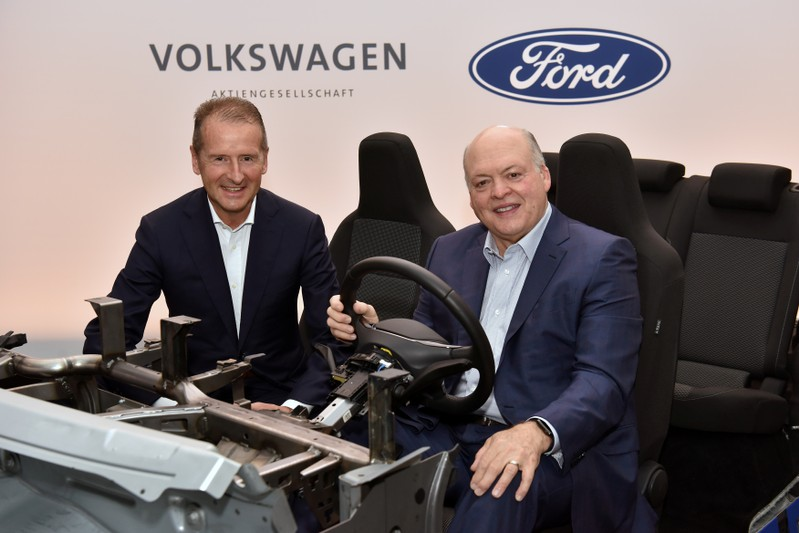 Volkswagen CEO Herbert Diess and Ford President and CEO Jim Hackett appear in a prototype