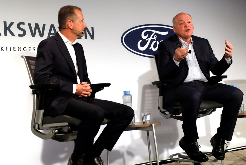 Ford President and CEO Jim Hackett and Volkswagen AG CEO Dr. Herbert Diess speak during a news