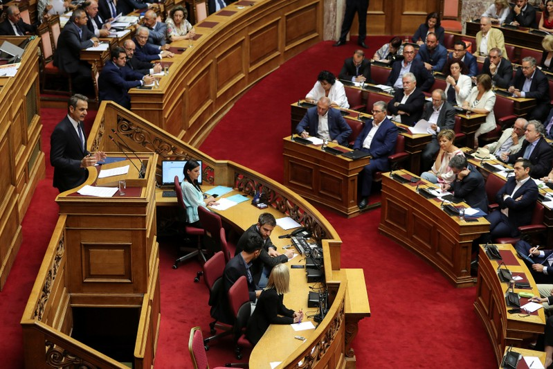 Greek PM Mitsotakis presents his government's main policies as Syriza party leader Tsipras