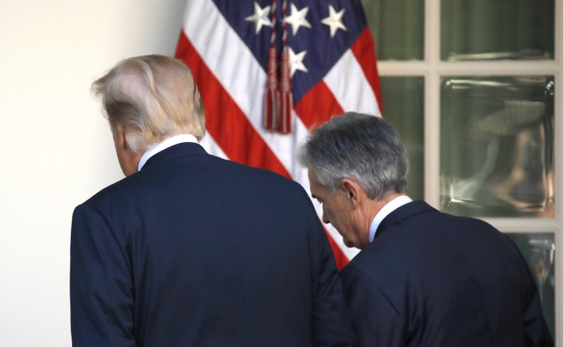 FILE PHOTO: U.S. President Donald Trump leaves the Rose Garden with Jerome Powell, his nominee