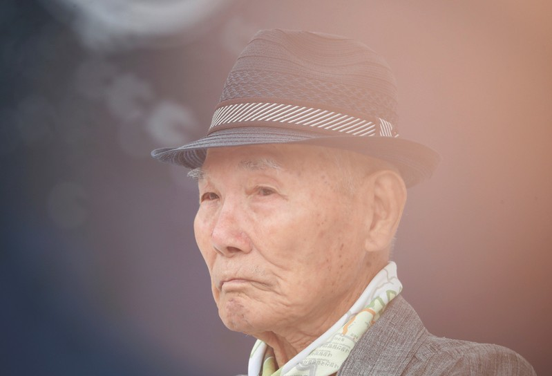Lee Choon-shik, a victim of wartime forced labor during the Japanese colonial period, reacts as