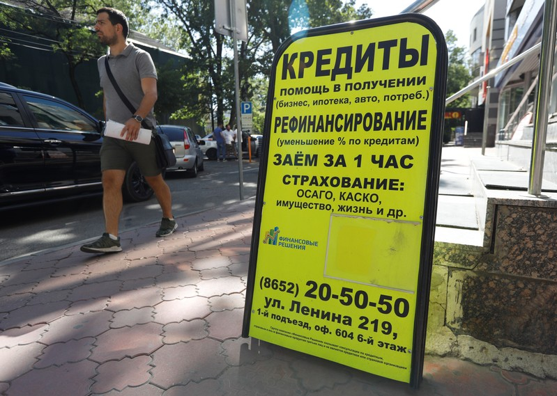 An advertising board of a lending agency is on display in Stavropol