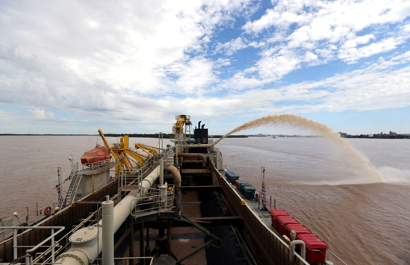 FILE PHOTO: A dredging boat sprays sand at the shore on the Parana river near Rosario,