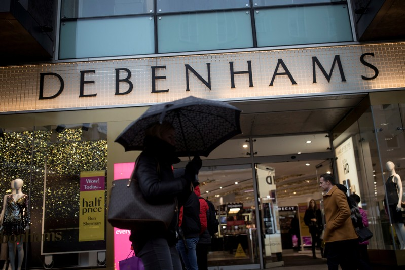 FILE PHOTO: Shoppers walk past the Debenhams department store on Oxford Street in London