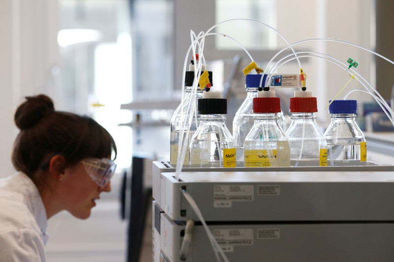 A staff works in a laboratory during a media visit for the inauguration of the Nestle Institute