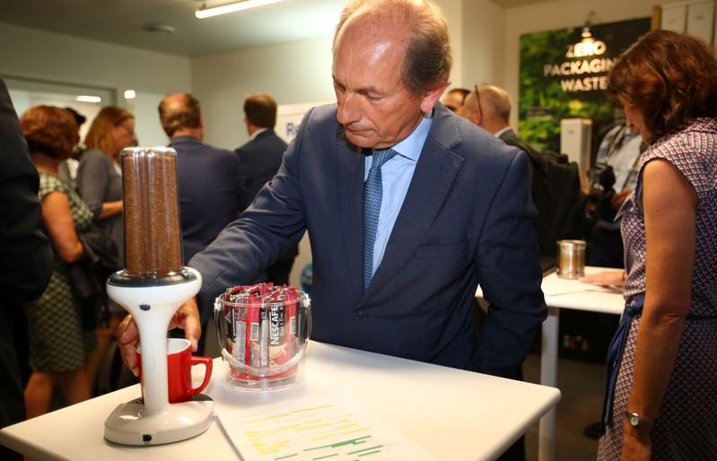 Swiss food giant Nestle Chairman Bulcke checks some Nescafe distribution device in Lausanne