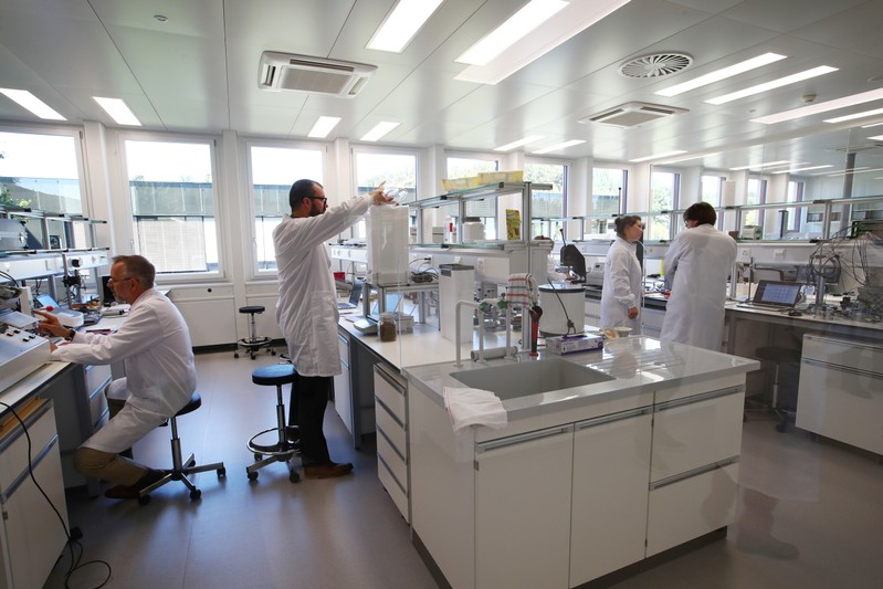 Staff work in a laboratory during a media visit for the inauguration of the Nestle Institute of