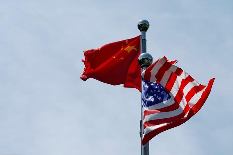 FILE PHOTO: FILE PHOTO: FILE PHOTO: Chinese and U.S. flags flutter near The Bund in Shanghai