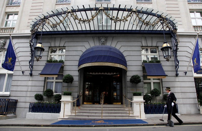 FILE PHOTO: An employee cleans outside the Ritz Hotel in London, Britain