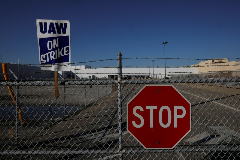 A union strike sign is stuck in the fence outside the GM Flint Truck Assembly in Flint