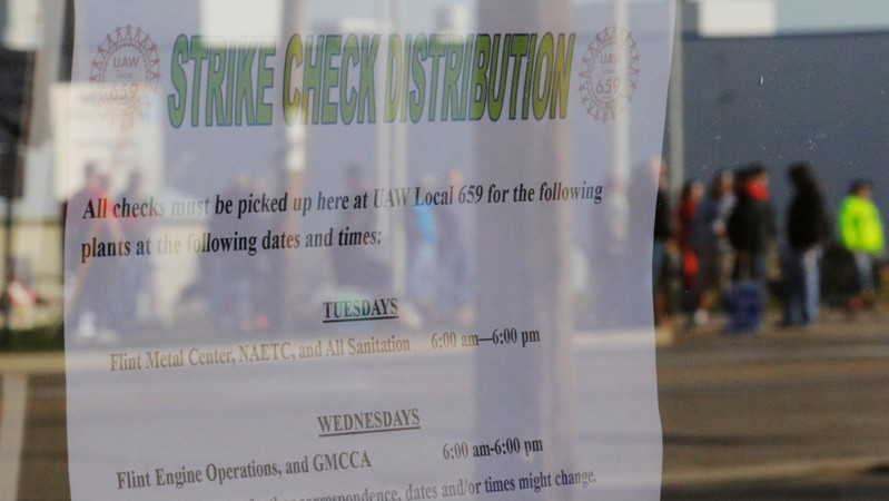 A window with the strike check distribution schedule reflects the picket line outside the GM