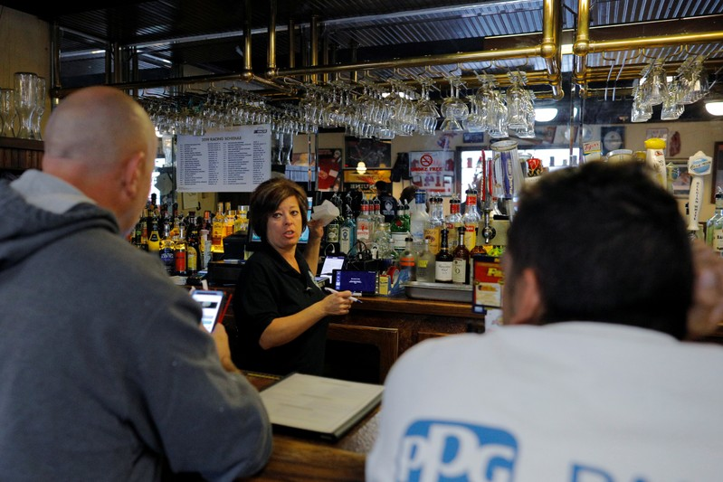 Jeanne Bonner works behind the bar at Latina Restaurant & Pizzeria near the GM Flint Truck