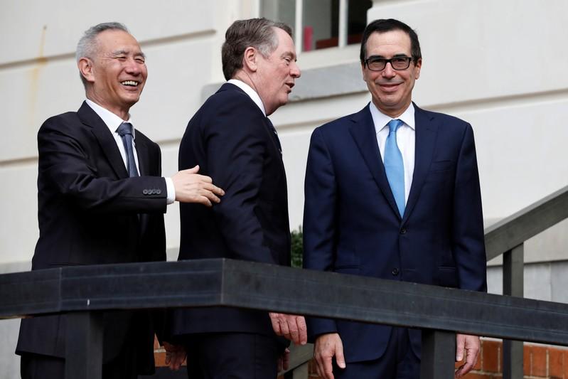 U.S. Treasury Secretary Steve Mnuchin greets China's Vice Premier Liu He