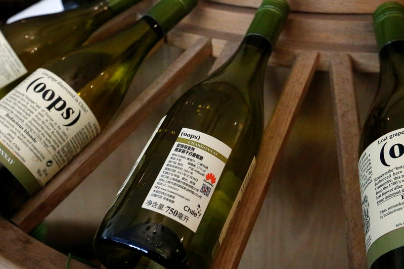 Wines with Huawei logo on the label are displayed for sale at a Huawei Mossel shop in Huawei's