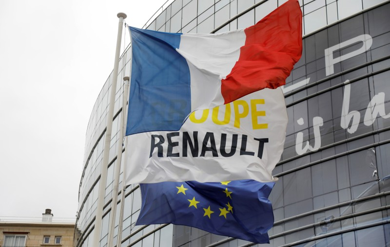French, EU and Renault flags flutter in front of French carmaker Renault headquarters ahead of