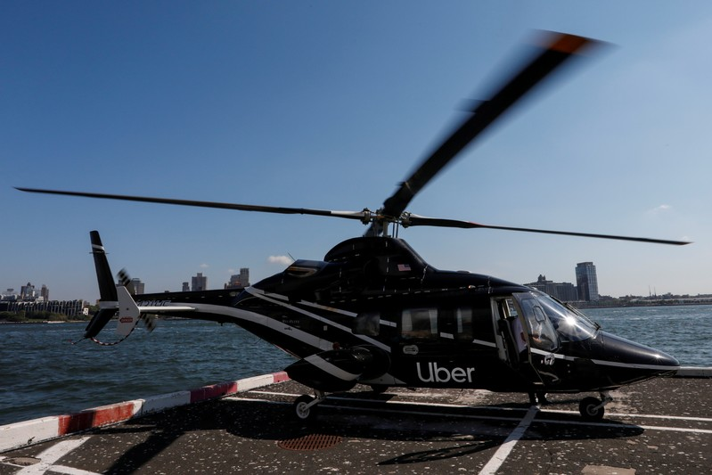 FILE PHOTO: A helicopter operated by Uber Copter, a new service by the ride-sharing company