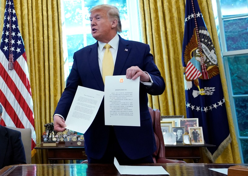 U.S. President Trump holds letter from China's President Xi Jinpingduring meeting with China's