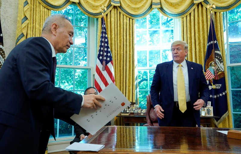 China's Vice Premier Liu speaks with U.S. President Trump during a meeting at the White House