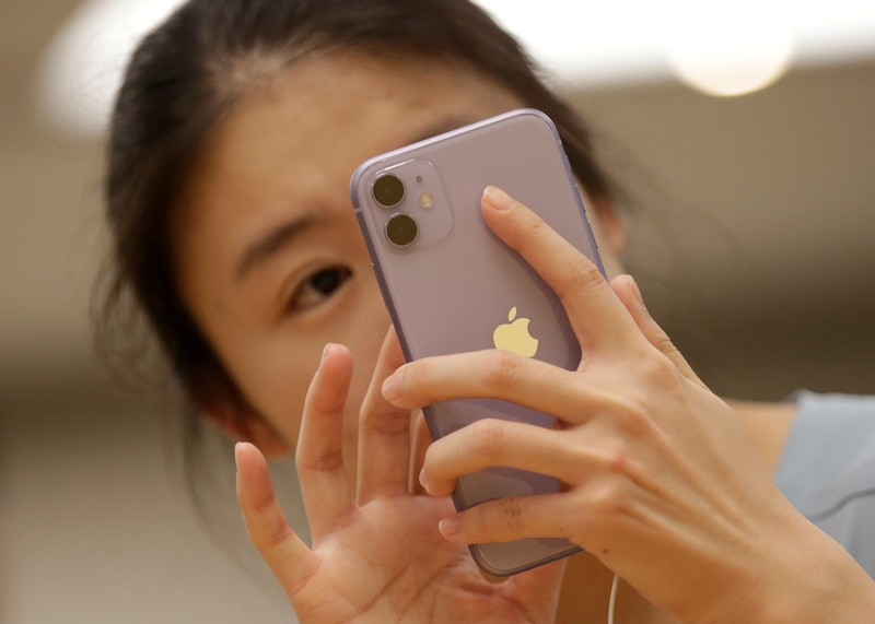 FILE PHOTO: A customer tests Apple's iPhone 11 after it went on sale at the Apple Store in