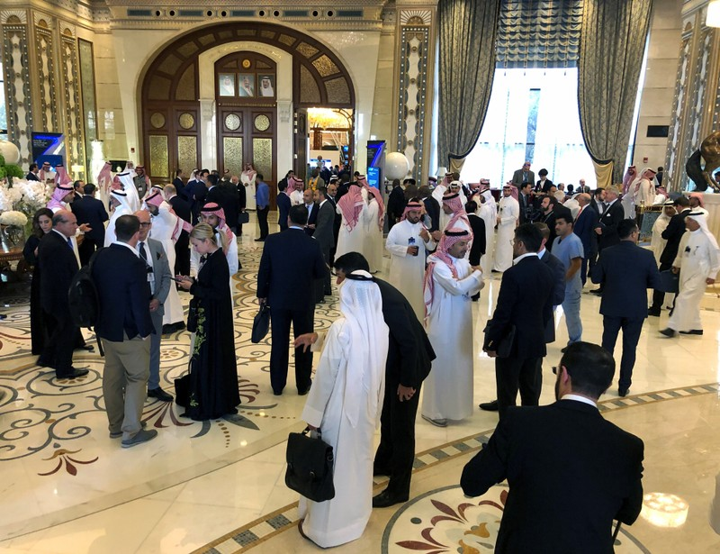 Participants take a break during the Future Investment Initiative conference in Riyadh