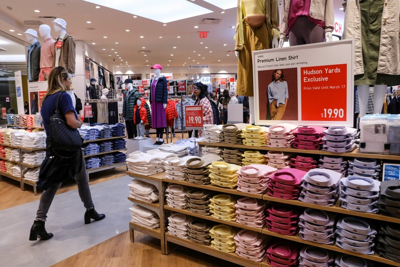 FILE PHOTO: FILE PHOTO: People shop at an H&M store during the grand opening of the The Hudson