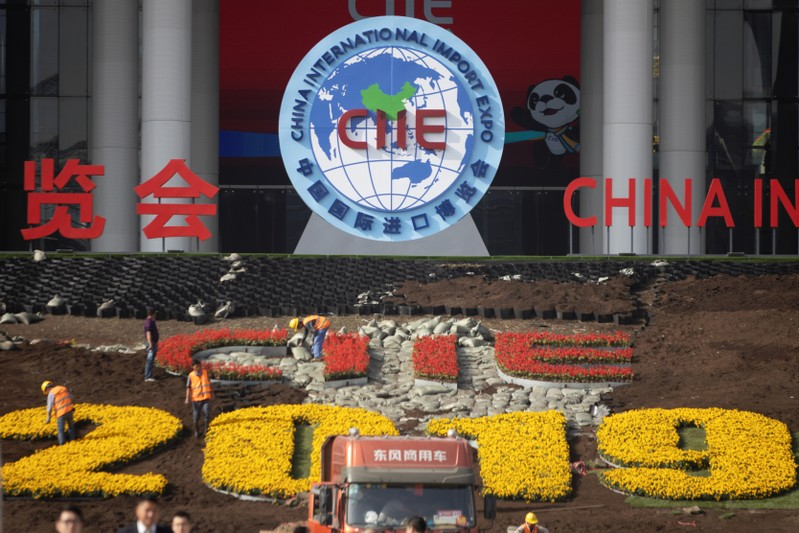 Workers set up the venue for the second China International Import Expo in Shanghai