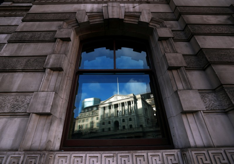 FILE PHOTO: The Bank of England is reflected in a window in the City of London