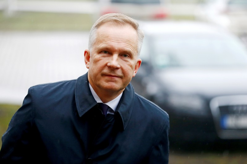Latvia's central bank governor Ilmars Rimsevics, accused of accepting bribes, attends court