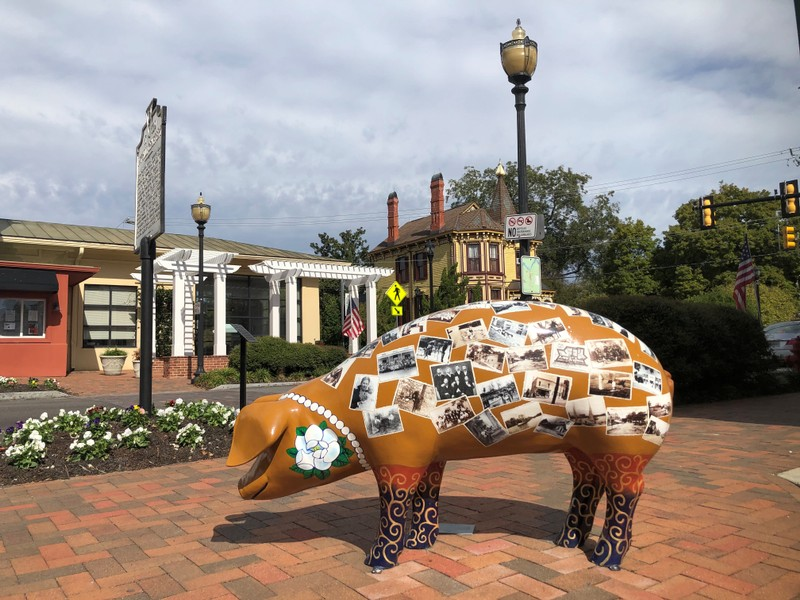 A sculpture of a pig is seen in downtown Smithfield