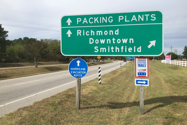 A road sign directs traffic to Smithfield Foods' pork processing facilities in Smithfield
